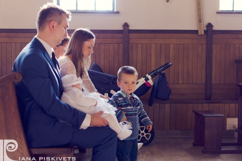 Present at the christening. Photographer christening Warsaw. The ceremony of baptism Piaseczno.